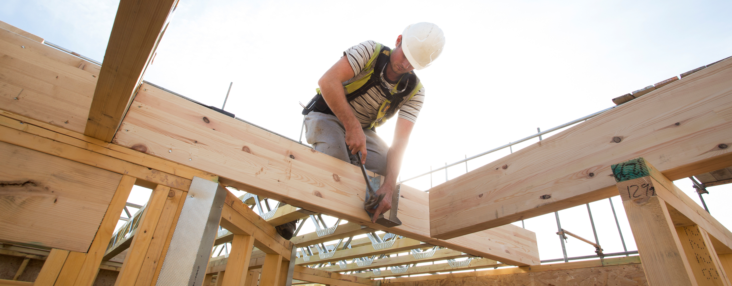 person working on building framing